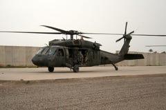 Soldados en helicóptero en Iraq Foto de archivo
