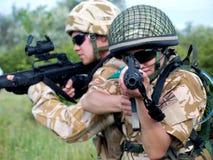 Soldados en la acción Fotografía de archivo libre de regalías