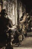 Soldados en uniforme militar del camuflaje Imagenes de archivo