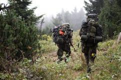 Soldados especiales en el bosque Fotografía de archivo libre de regalías