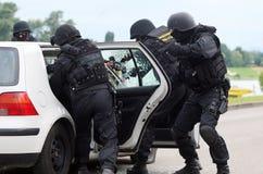 Soldados que rebentam o terrorista Foto de Stock