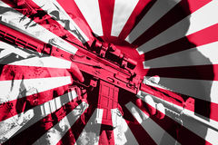 Soldat avec la mitrailleuse avec le drapeau national du Japon Image stock