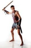Soldat de Rome avec l'épée sur le blanc Photo stock