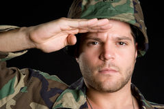 Soldat de salutation Photographie stock libre de droits