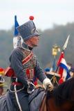 Soldat för Napoleonic krig - reenactoren rider en häst Royaltyfri Fotografi