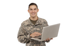 Soldat heureux avec l'ordinateur portable Photo libre de droits
