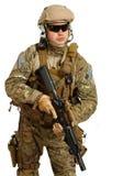 Soldat med geväret på en vit bakgrund Royaltyfri Foto