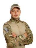Soldat med geväret som isoleras på vit bakgrund Royaltyfri Bild