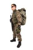 Soldat mit Gewehr auf einem weißen Hintergrund Lizenzfreies Stockfoto