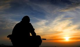 Soldat am Sonnenuntergang Stockfoto