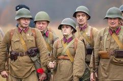 Soldati con i fiori Immagine Stock