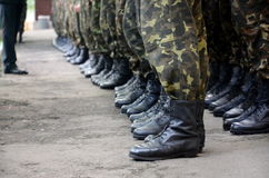 Soldatkängor i armé Arkivbilder