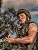 Soldato con l'arma Immagine Stock