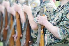 Soldats avec le camouflage de militaires Photo stock