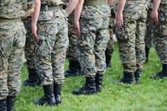 Soldats avec le camouflage de militaires Image libre de droits