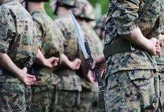 Soldats avec le camouflage de militaires Images stock