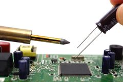 Solder the capacitor on the motherboard Royalty Free Stock Photo