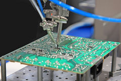 Solder the chip on the PCB Stock Photos