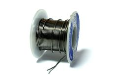 Solder spool. Spool of solder on a white background royalty free stock photo