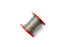 Solder wire on a spool on white background Royalty Free Stock Image