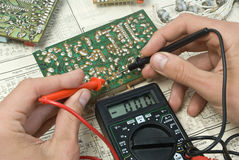 Soldering. On drawings close-up Stock Photo