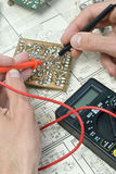 Soldering. On drawings close-up Stock Photos