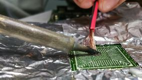 Soldering chip on the soldering station with alignment royalty free stock image