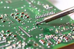 Soldering a circuit board Royalty Free Stock Image