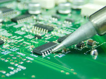Soldering component electronic circuit. With soldering iron Royalty Free Stock Photos
