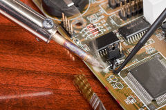 Soldering a computer board Stock Images