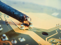 Soldering contacts on the board. With a soldering iron perfect heat stock photo