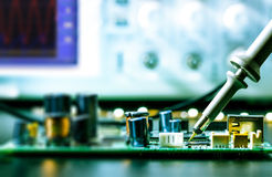Soldering  electronic circuit board Royalty Free Stock Images