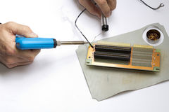 Soldering electronic component Stock Photo