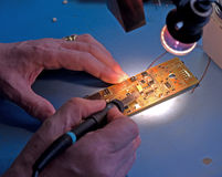 Soldering electronic components. Stock Photography