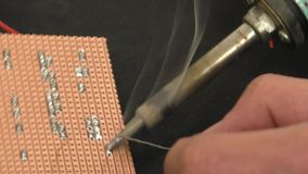 Soldering electronic components stock footage