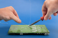 Soldering electronic parts on board Stock Photo