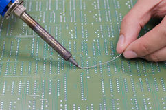 Soldering electronic parts on board Royalty Free Stock Photography