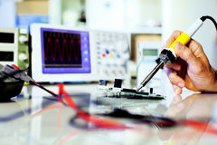 Soldering. Electronic parts on a printed circuit board royalty free stock images