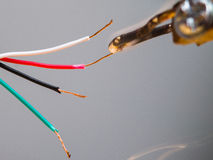 Soldering of electronic wires royalty free stock images