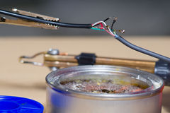 Soldering of electronic wires stock images