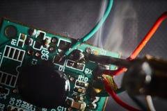 Soldering electronics stock image