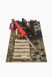 Soldering iron and computer motherboard Stock Image