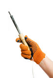 Soldering-iron in hand Royalty Free Stock Images