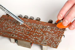 Soldering iron in his hand Royalty Free Stock Photo