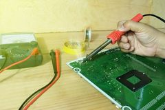 Soldering iron, lead, circuit board. And Analog Multimeter Royalty Free Stock Photos