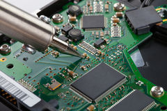Soldering iron and microcircuit Royalty Free Stock Image