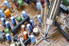 Soldering iron ,repair electronic boards Royalty Free Stock Photos