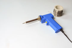 Soldering iron and solder wire Stock Images