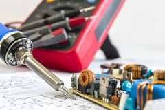 Soldering iron and 12V pulse source Royalty Free Stock Image