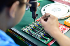 Soldering of microchip Stock Photo